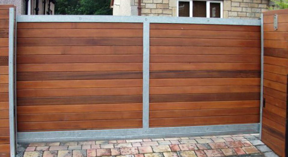 Sliding driveway gate with swing gate design