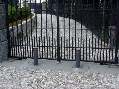 Rising bollards as added security for automatic gates
