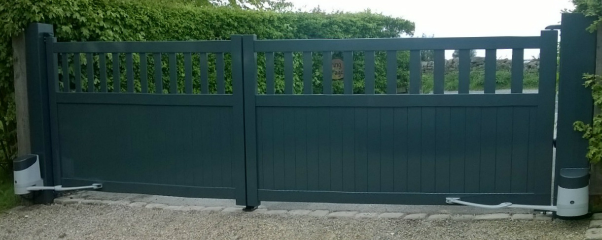 green automated gate on driveway