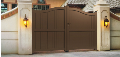 brown automated gate front with lights