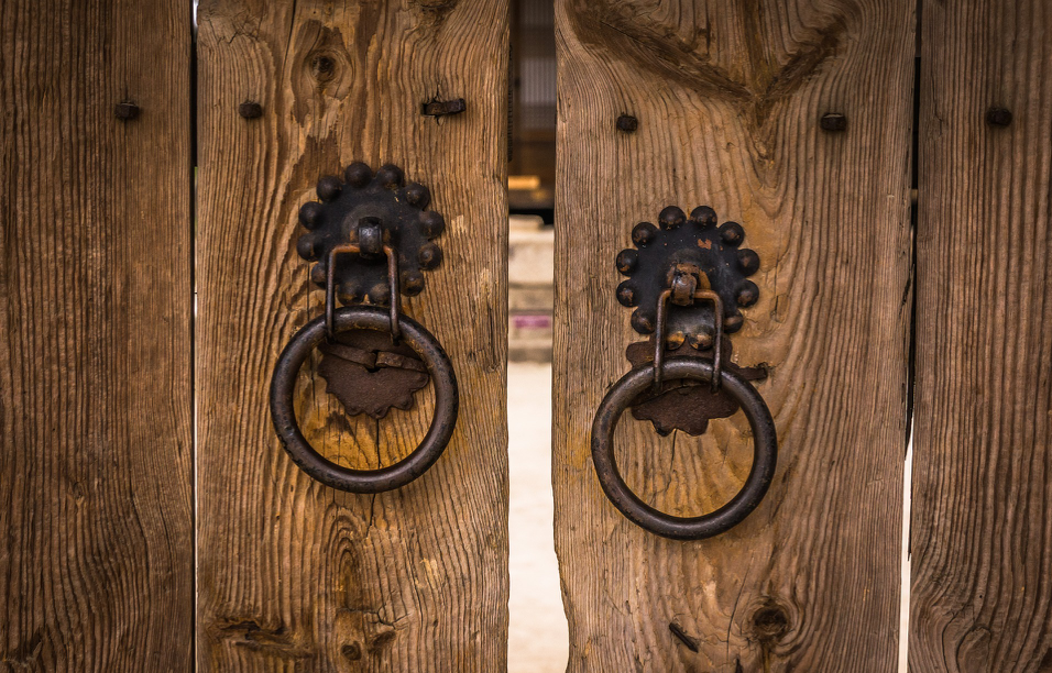 brown wooden closed gates with metal handles