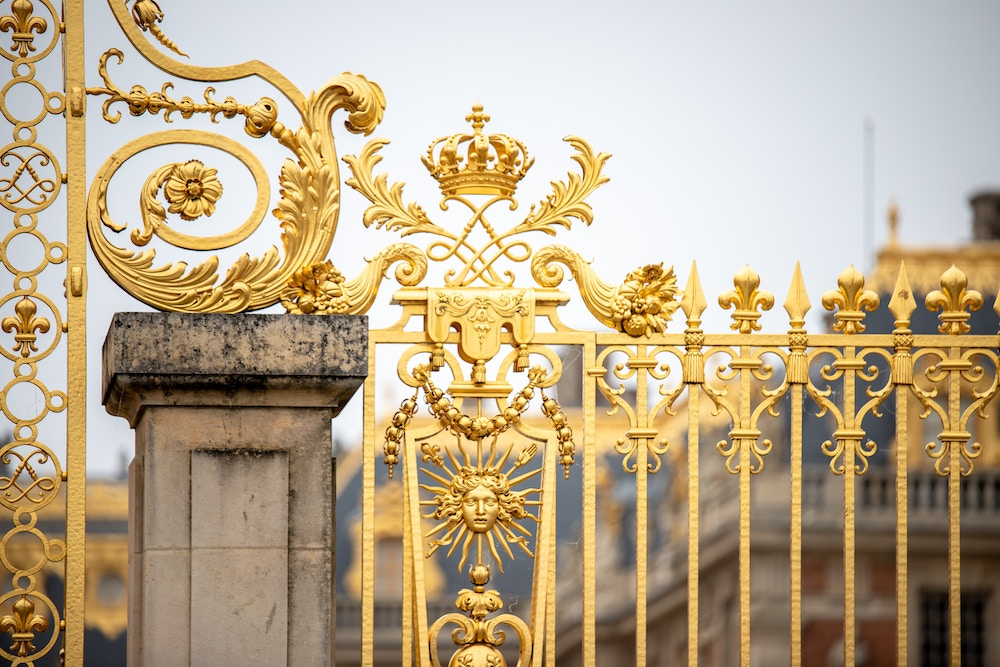 intricate gold steel gate design