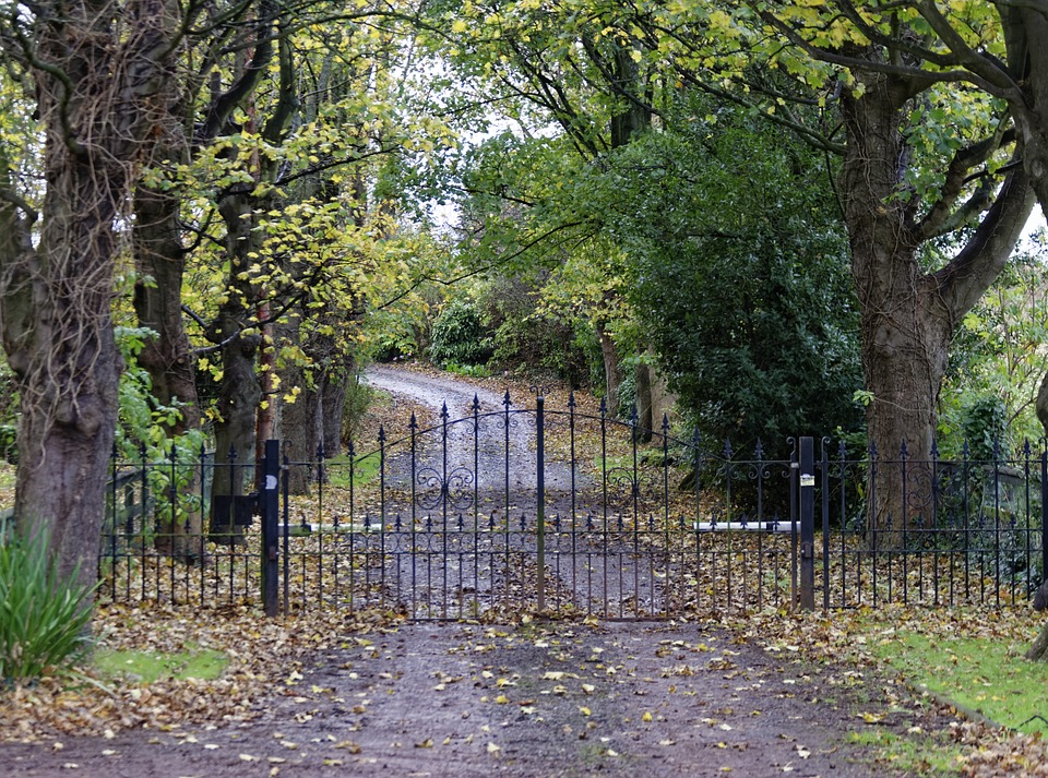 An automatic swing gate at the end of a country lane