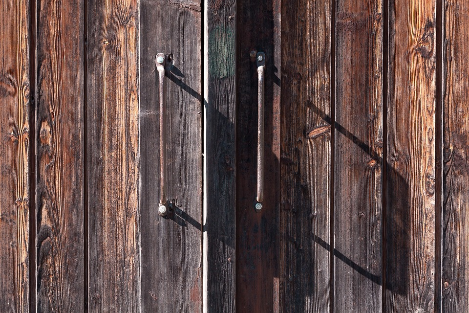 An old wooden gate with metal handles