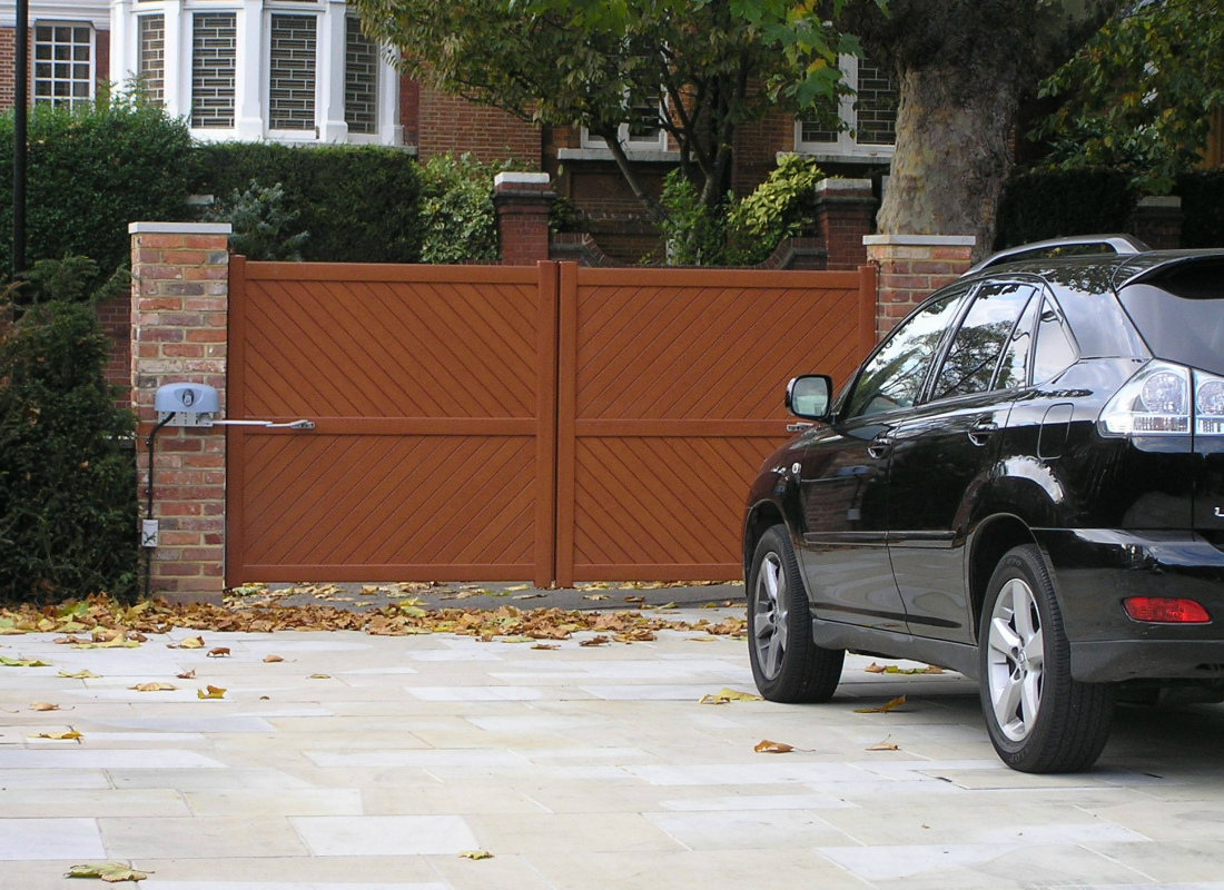 Wood effect aluminium automatic swing gates by Linkcare
