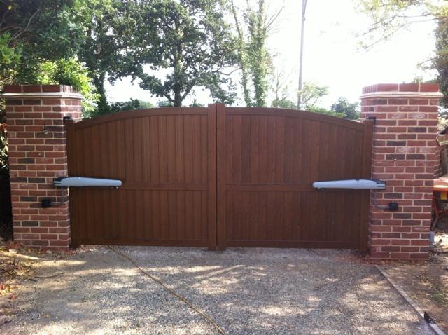 Articulated arm gate motors automated wooden finish aluminium gates
